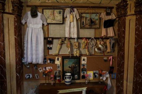 Residents began abandoning La Estrella and other rural towns in 1939, at the end of Spain's civil war. Here, offerings are placed behind the altar at the village sanctuary.