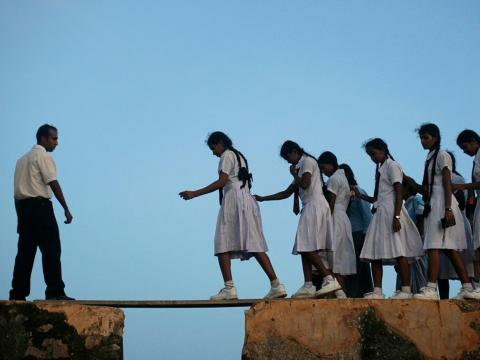 In Sri Lanka, some girls must cross wooden planks laid over the walls of a 16th century fort in the coastal town of Galle.