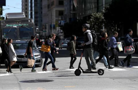 A user riding a Spin scooter on April 17 in San Francisco.