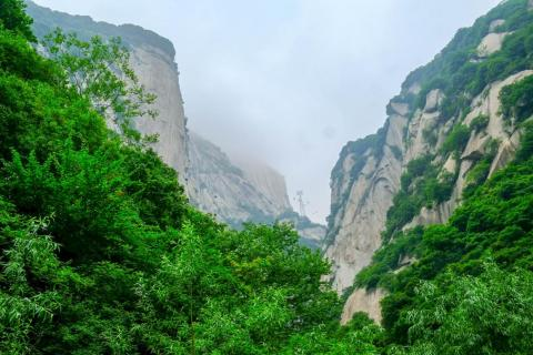 In China, I headed to Mount Hua, or Huashan, considered to be one of China's five sacred mountains and one of the most popular tourist attractions and pilgrimage sites for Chinese people. The mountain actually has five main peaks: