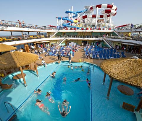 Above deck, we find the Lido Beach Pool, where passengers can hop in for a cool swim.