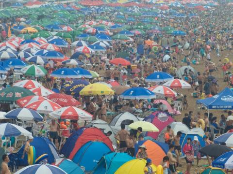 """But beach vacationers will have to fight to get a spot, judging from photos such as this one from Fujiazhuang beach in Dalian on a nearly 90-degree day in 2015. """"I went on a weekday and almost could only see the water through"""