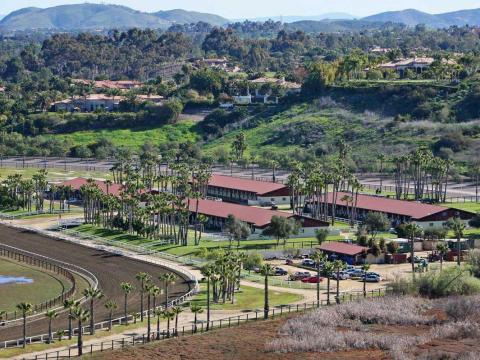 In California, he owns the 228-acre Rancho Paseana, which he purchased for $18 million. It includes a racetrack, orchard, and five barns.