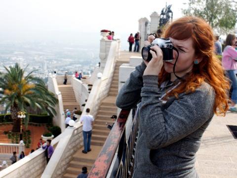 chica con cámara fotográfica