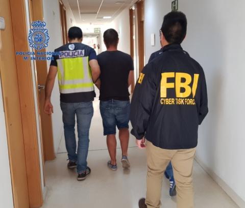 Imagen de la detención del miembro de Fin7.