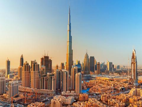 """Dubai is known for its luxury shopping and hotels, giant malls, and ultra-modern architecture. Rough Guides calls it """"one of the world's most glamorous, spectacular and futuristic urban destinations."""""""