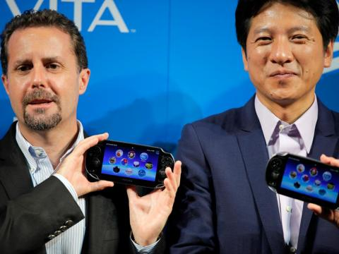 Former Sony Computer Entertainment Inc. (SCE) Group CEO Andrew House, left, and SCE Japan President Hiroshi Kawano debuted the PlayStation Vita during a press conference in Tokyo on Wednesday, Sept. 14, 2011.