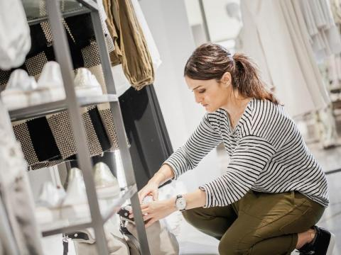 Inside, Zara's team of visual-merchandising experts are hard at work curating the store layout. It looks exactly like your typical Zara store, with the signature black-and-white color scheme and clothing displayed on racks and on