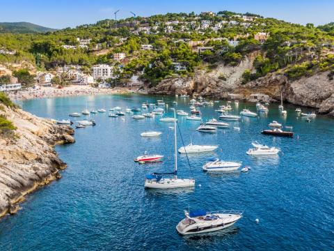 Located in the Balearic Islands of Spain and around 220 square miles, Ibiza is known both for its swanky beach hotels and villas frequented by the wealthy and famous and for its thumping nonstop clubbing scene.