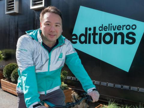 Will Shu in a Deliveroo rider's distinctive, reflective uniform.