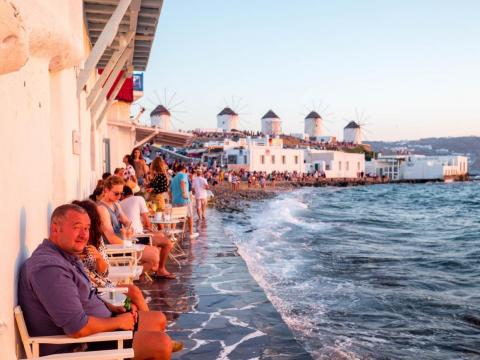 The most popular place to watch the sunset in Mykonos is Little Venice, a row of fishing houses that line the waterfront. The area has been converted into restaurants and bars, with chairs overlooking the surf.