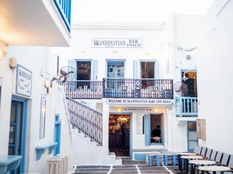 Mykonos' nightlife is known for being intense, going deep into the night. It's mostly focused around bars like Skandinavian Bar & Disco, a landmark spot on the island.