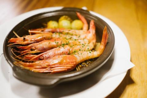"One of the local dishes was this Gambas al Ajillo ""Nobu Style,"" a classic Spanish dish ($50) which used shrimp from nearby Formentera. It was a simple, garlicky dish that shined with the local, fresh seafood."