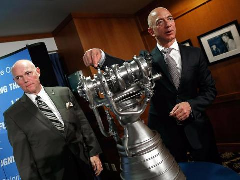 Bezos with a model rocket.