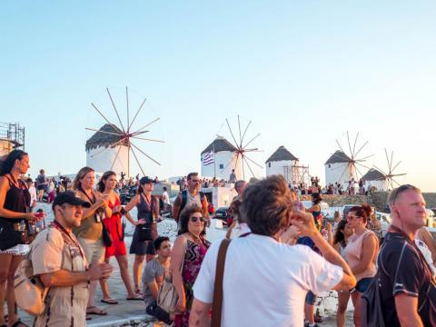 """""""Outside of the beaches, the main thing to see in Mykonos is the windmills that sit above the Hora, or main town of the island,"""" Jacobs wrote. """"But during sunset, and when the cruise-shippers come in, the area is swarmed with"""