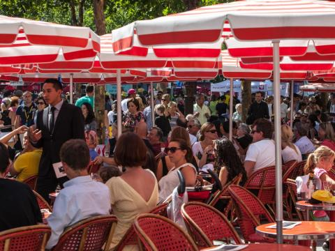 The terraces can be as crowded as the sidewalks. Travel + Leisure included the Champs Elysées on its list of the 95 most overrated attractions in the world, noting that apart from the view of the famous Arc de Triomphe and the