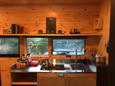 "A tiny house means you'll no longer have a full kitchen — a mini fridge and lack of counter space can be a problem if you like to cook. ""I see tiny houses with mini-fridges and a two-burner stove top with no oven,"" Justin, a Tiny"