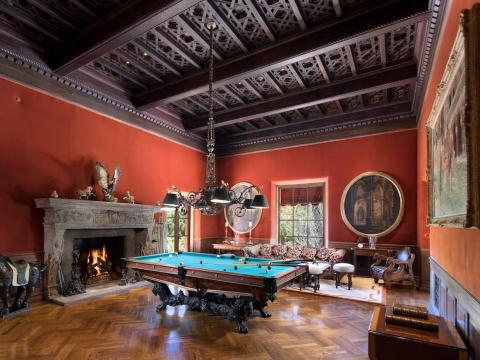 The 32-foot billiards room is open to the main hallway.