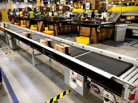 After items are entered into the system and stowed in bins, they're sent along the conveyor belt to be boxed up.