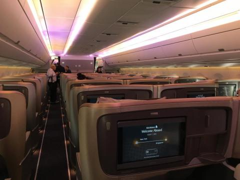 On board, I made my way through the business-class cabin to my seat. Our plane had only 161 seats, with 67 in business ...