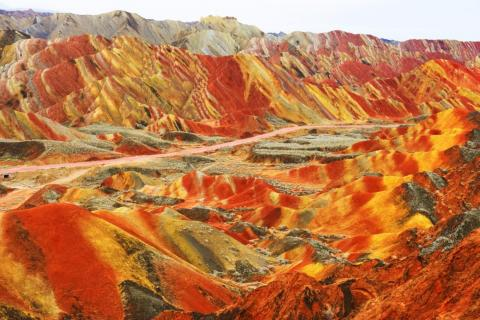 "China has lots of unique natural landscapes and geological formations. One of the most interesting ones I saw on Reddit prior to my visit to China was the Danxia landform of Zhangye, also known as the ""rainbow mountains."""