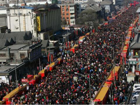 """The Chinese New Year celebration in Beijing is a spectacle, but the crowds are so large the holiday is also referred to as the world's """"largest human migration."""""""