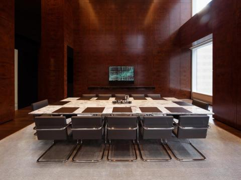 ... a conference room with a marble table that seats 14 ...