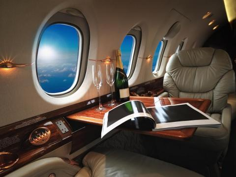 Flying on a private jet is a completely different experience than flying commercial, Eric Roth, president of International Jet Interiors, a company that designs interiors of private jets, told Business Insider.