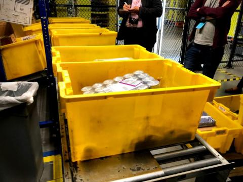 "The fulfillment center relies heavily on these yellow bins, which I saw everywhere throughout my tour. Each has a barcode, and items that arrive at the fulfillment center are sorted into them using a process Amazon calls ""random"