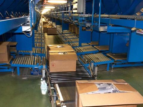 The full boxes are then placed on another conveyer belt to be sent out for delivery.