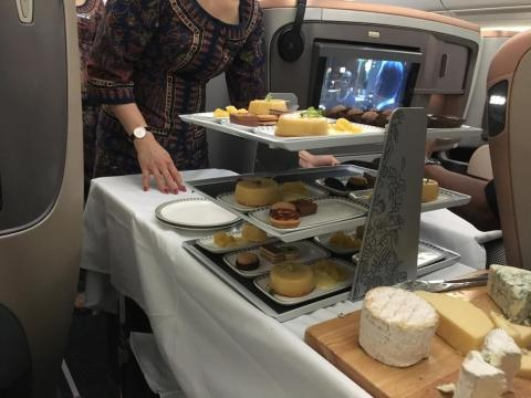 Flight attendants also came by each seat with a cart of cheeses, fruits, and desserts.