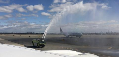 Next, fire trucks commemorated the special occasion with a water-cannon salute.