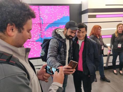Pete Lau, the founder of OnePlus, taking selfies with fans at the Times Square T-Mobile store.