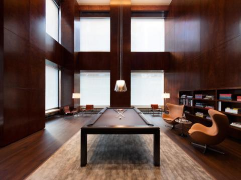 Other amenities at 432 Park include a billiards room and a library ...