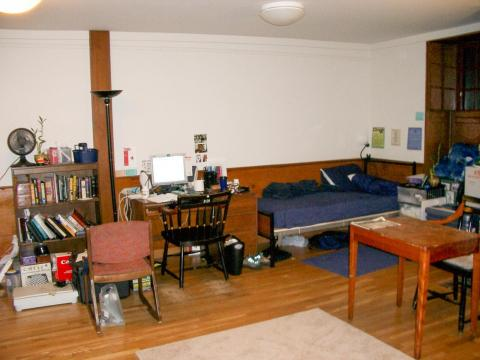 Other dormitories, like the first-year house of Stoughton, feature a large single room layout with two beds.