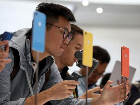 Visitors inspecting the new iPhone XR during an Apple event at the Steve Jobs Theatre on September 12 in Cupertino, California.