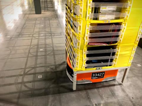 The robots rely on QR codes on the floor to map the room.