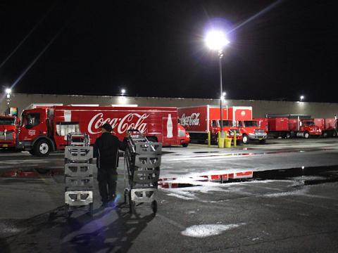 Santiago's truck changes every day, and his vehicle is already loaded by the time he gets in at 4 a.m. He just needs to load carts in the truck and do some final checks.
