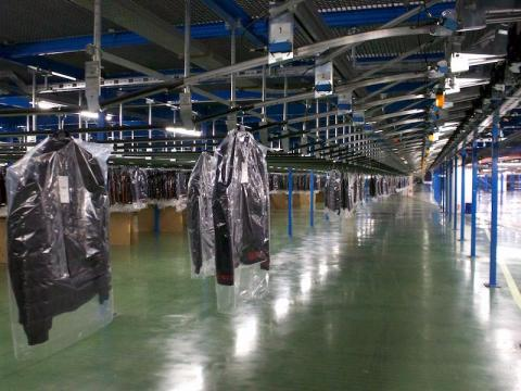 In a separate corner of the distribution center, hanging garments that have passed the separate quality-control process are also waiting to be shipped.