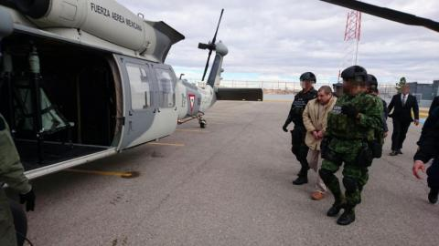 Guzman is escorted to a helicopter by soldiers during his extradition in Ciudad Juarez, Mexico, on January 19, 2017.