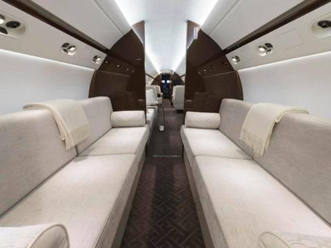 On some private planes, you can stretch out on a sofa instead of being squished between other passengers.