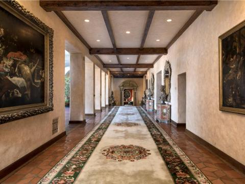 A stroll through the house would take you through its grand hallways, one of which is 82 feet long and the other more than 102 feet with a 40-foot wide mural.