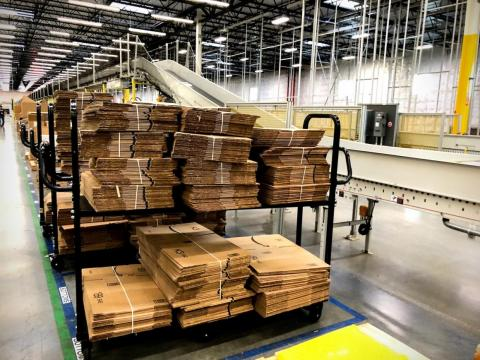 The ubiquitous Amazon box is everywhere you turn, in every size imaginable, throughout the fulfillment center.