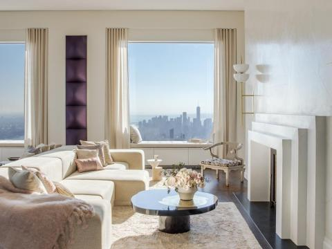 The unit, accessed by a private elevator, offers panoramic views of the city and Central Park.