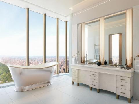 The walls and floors in master bathrooms are finished in veined white onyx, custom sconces, and bronze fixtures.
