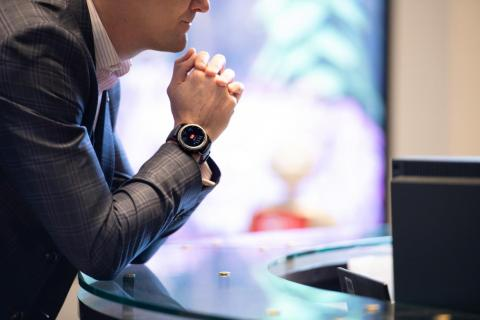 The watches, seen prominently here, elicit questions and interest from customers who are waiting to be served.