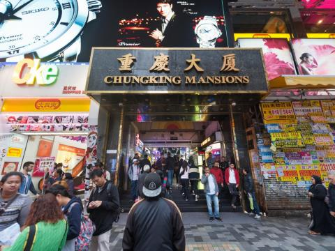 When doing research about Hong Kong, one place that kept coming up as a must-visit was Chungking Mansions. Alternately billed as the cheapest place to find a room in the city and a hotbed of illicit businesses, it is considered