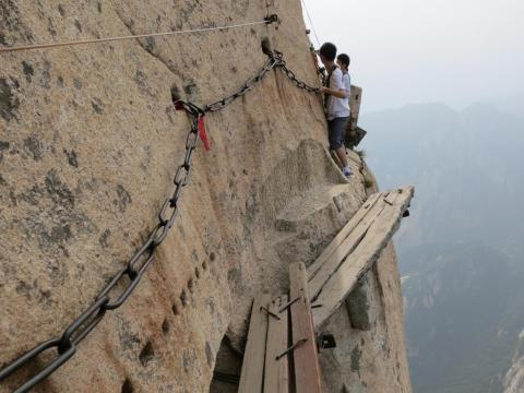 While breathtaking, it's considered to be one of the world's most dangerous places to hike, due in large part to the infamous plank walk located on the mountain's highest peak, South, which has a height of 7,070 feet.