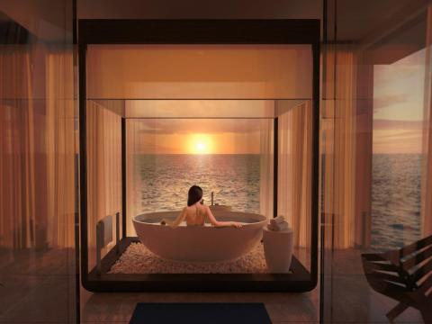 In addition to two bedrooms, the upper level has a bathroom with tub facing the ocean. But that's just one of many all-inclusive indulgences. There's a butler and chef for each suite, an on-call fitness trainer and spa treatments,