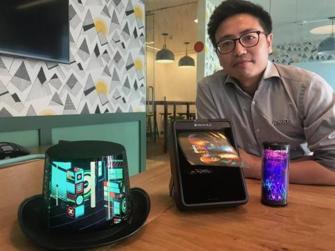 Bill Liu, CEO of Royole, with a selection of devices that use his company's flexible displays.